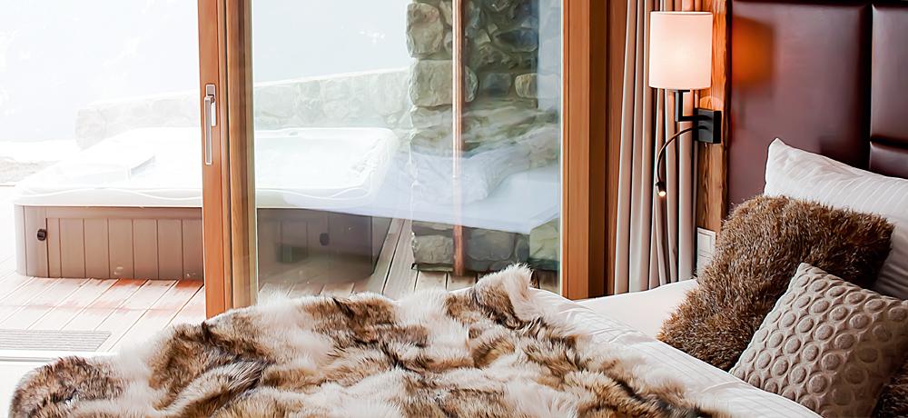 maierl chalets exklusive ausstattung mit sauna outdoor whirlpool. Black Bedroom Furniture Sets. Home Design Ideas